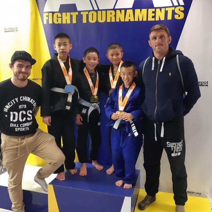 Kids winning after taking kids BJJ classes