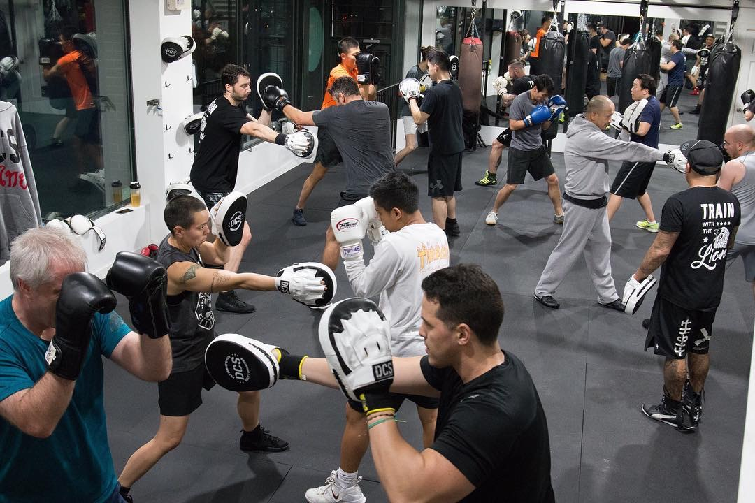 Pad work at boxing Vancouver classes